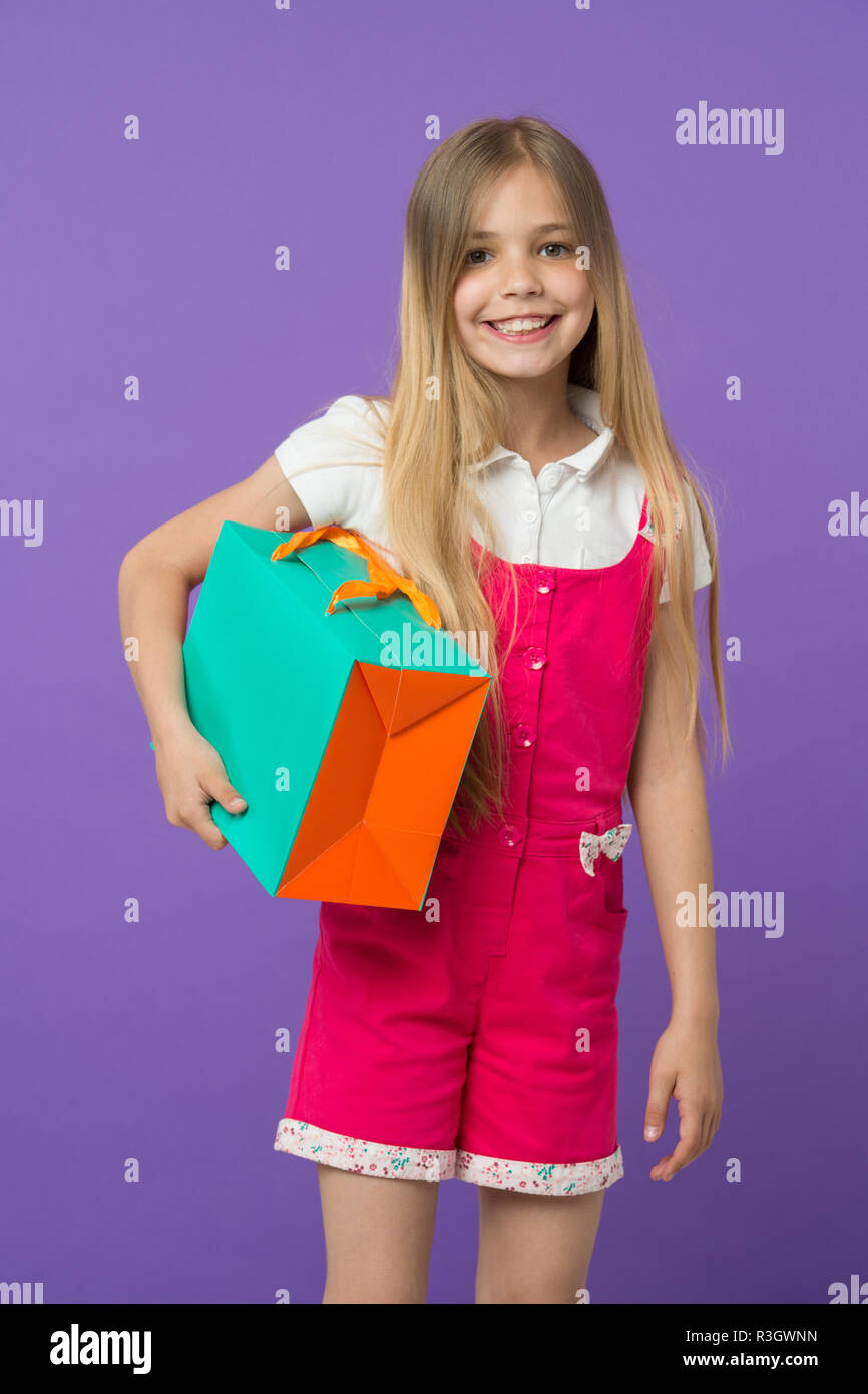 My choice. Simple reminders how to shop smart. Summer sale. Girl cute teenager carries shopping bag. Kid bought clothing summer sale. Seasonal sale co - Stock Image
