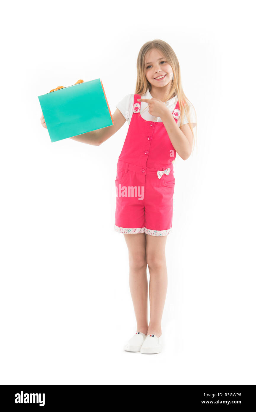 Get smart with coupons. Girl cute teenager carries shopping bag. Kid bought clothing summer sale. Loyalty program benefits. Loyalty programs remain ex - Stock Image