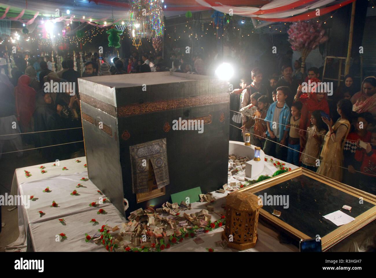 Pakistani people watching models of Masjid-e-Nabvi, Khana
