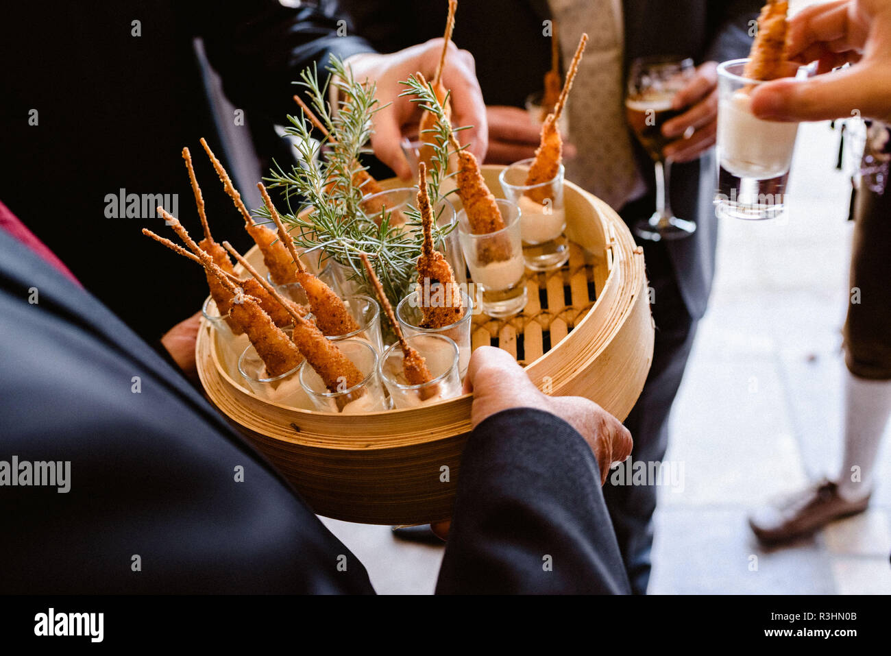 Tasty wedding appetizers served by waiters to the guests Stock Photo