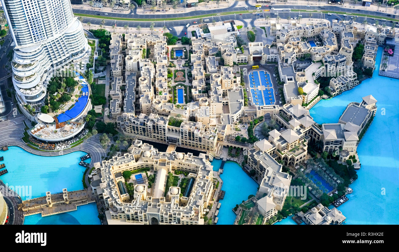 Dubai, United Arab Emirates - 31 October, 2018: Looking down at Dubai downtown district, luxury lifestyle apartments, palm trees and swimming pools. Stock Photo