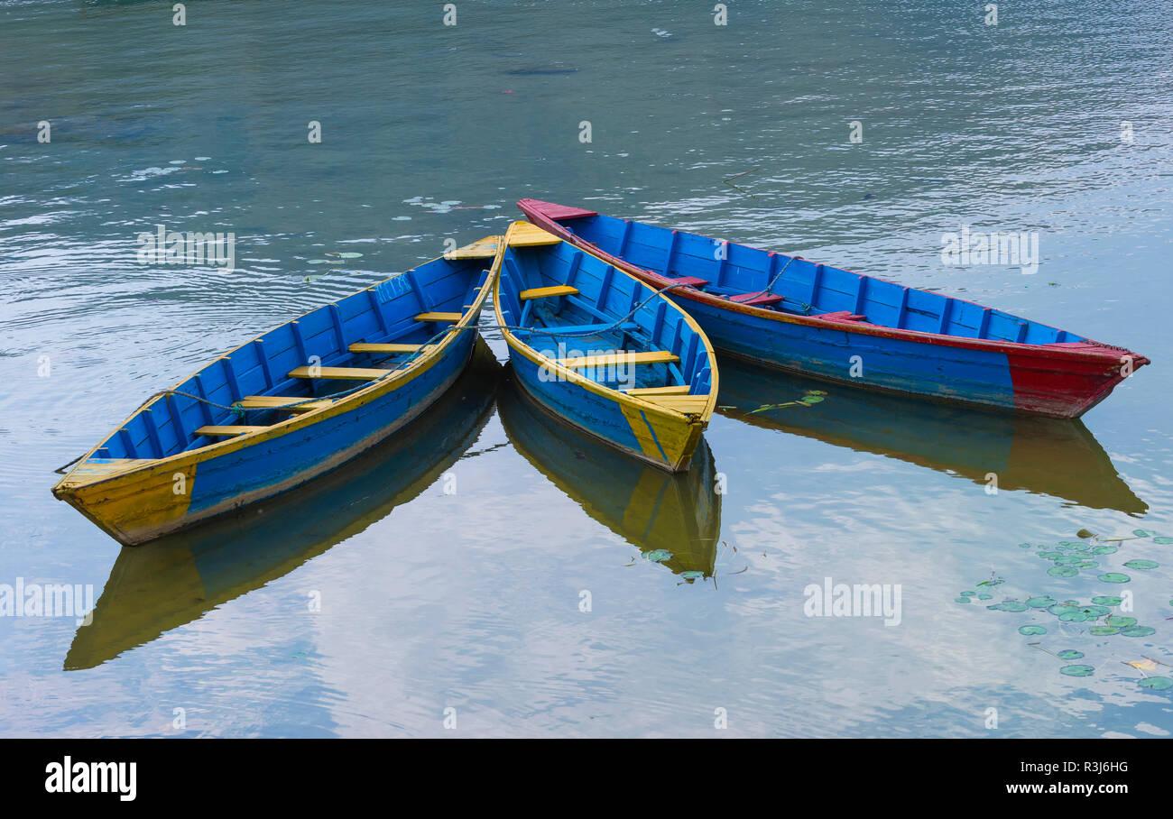 Colorful boats on Phewa Lake, Pokhara, Nepal - Stock Image
