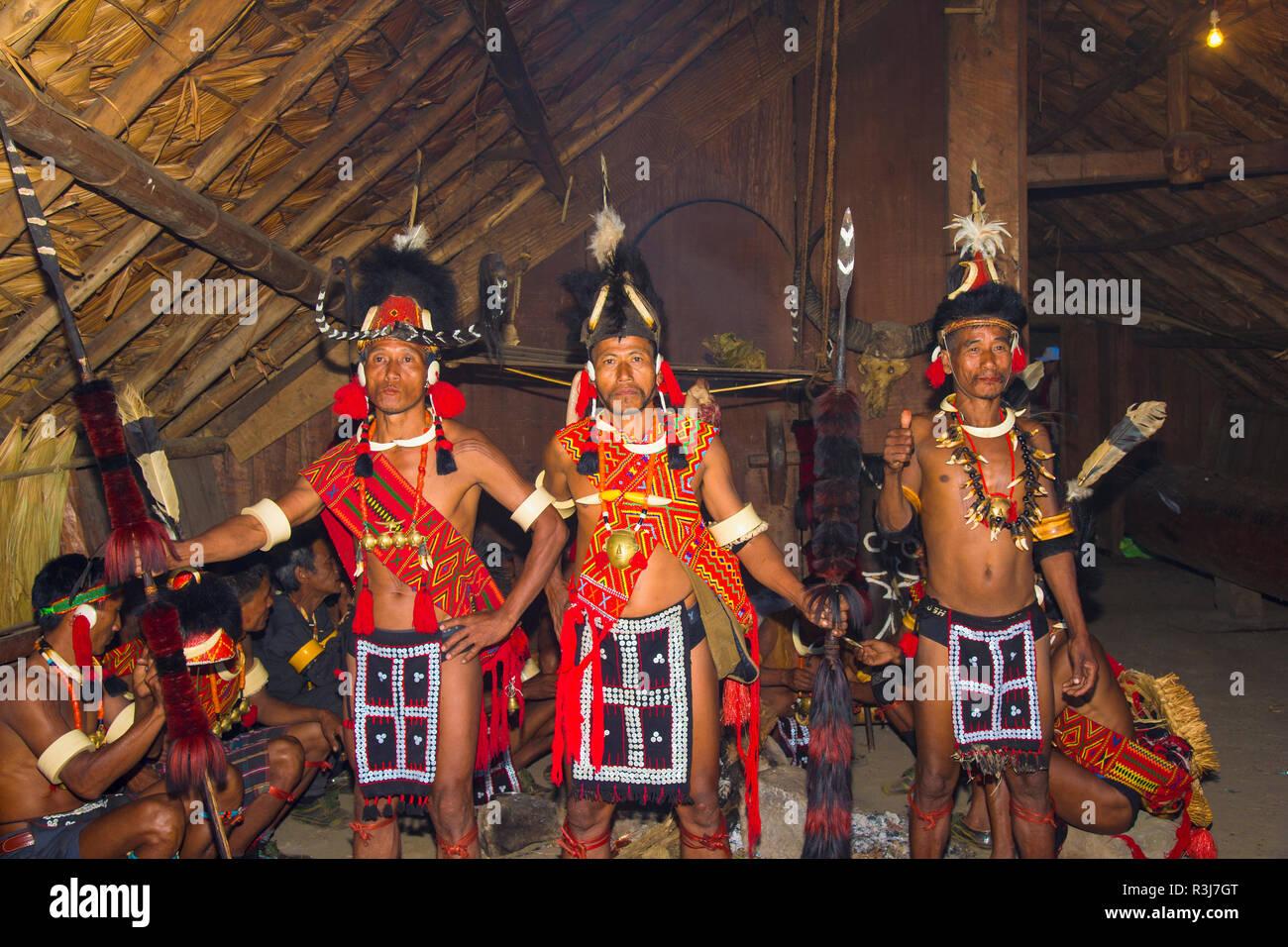 Naga tribal men in traditional clothing, Kisima Nagaland Hornbill festival, Kohima, Nagaland, India - Stock Image