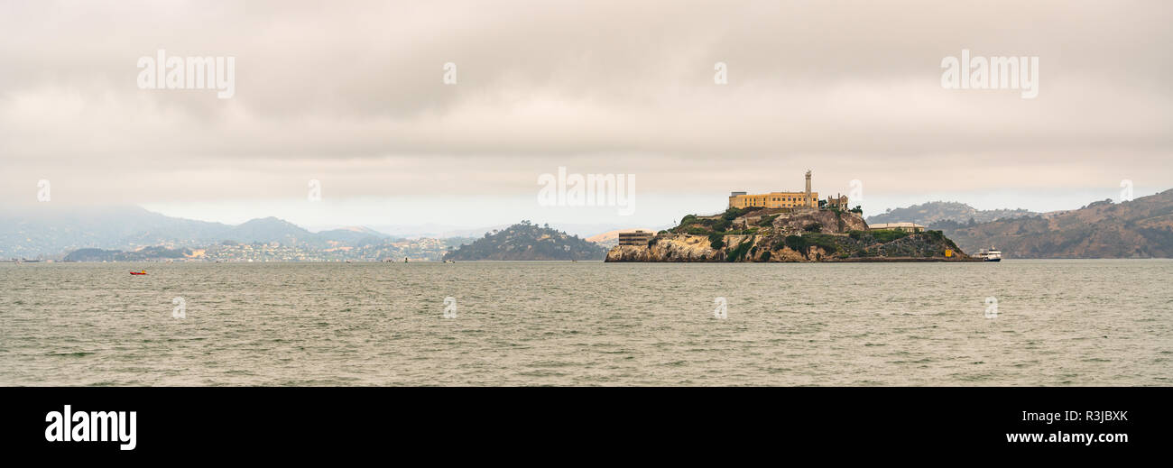 Famed isolated prison Island in the Bay at San Francisco tour boat docked - Stock Image