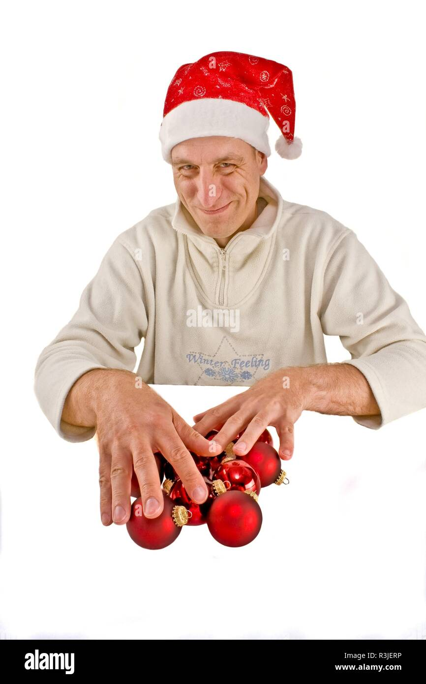 santa claus with christmas baubles - Stock Image