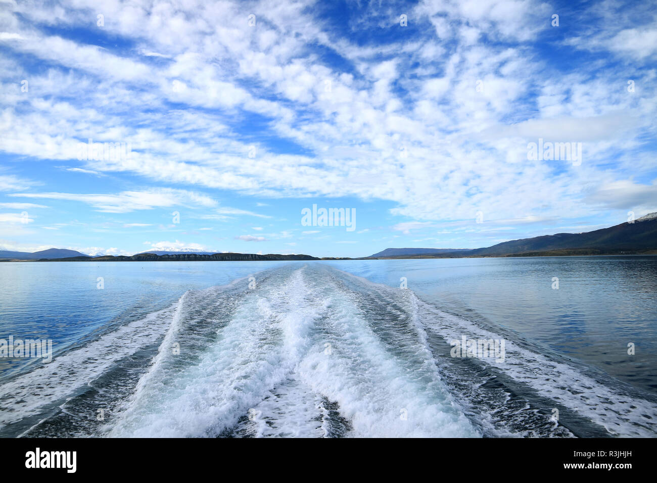 Powerful foaming water at the stern of cruise ship cruising the Beagle channel, Ushuaia, Tierra del Fuego, Argentina - Stock Image