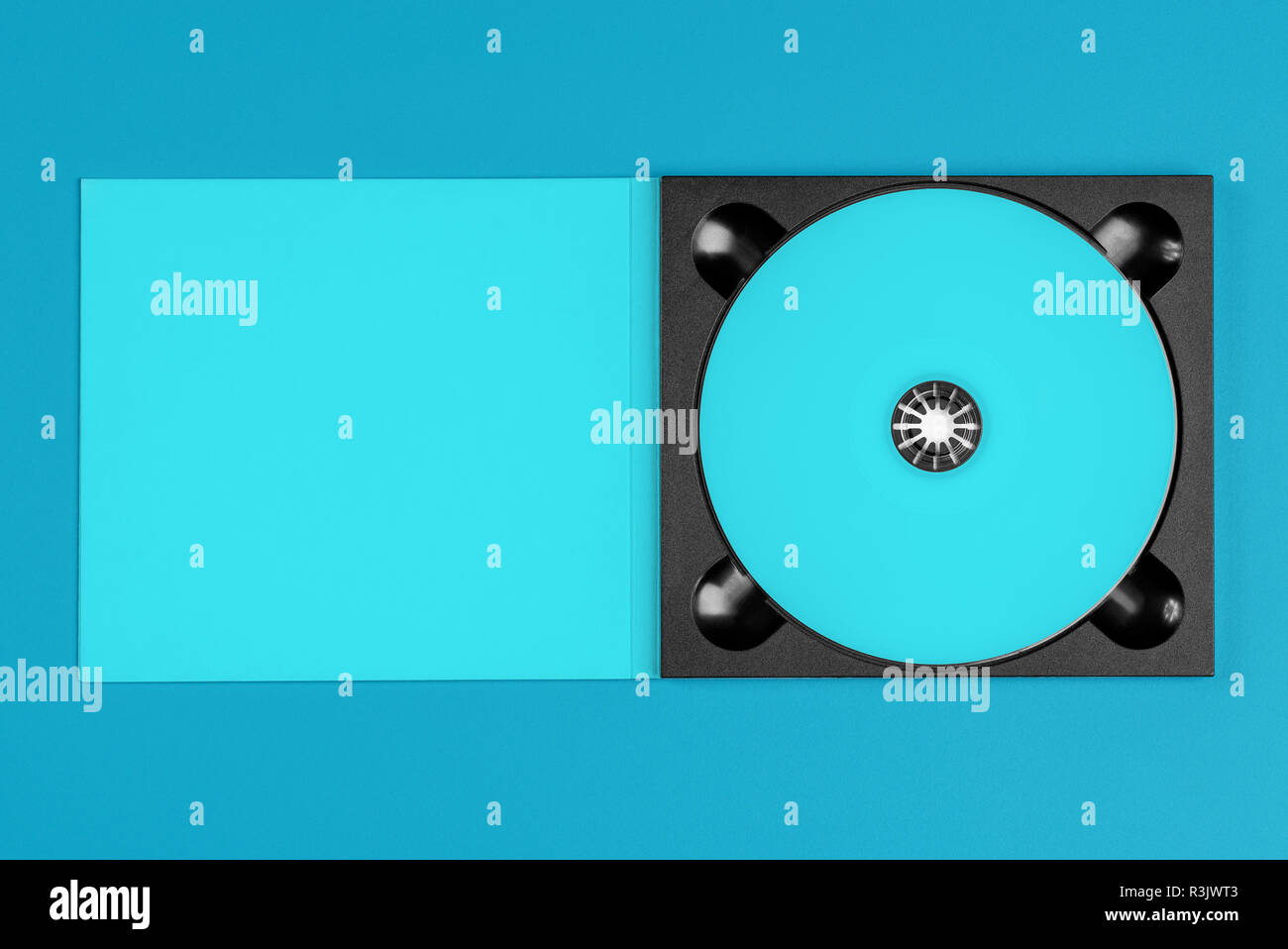 Pastel blue cd in case on pastel blue background Stock Photo