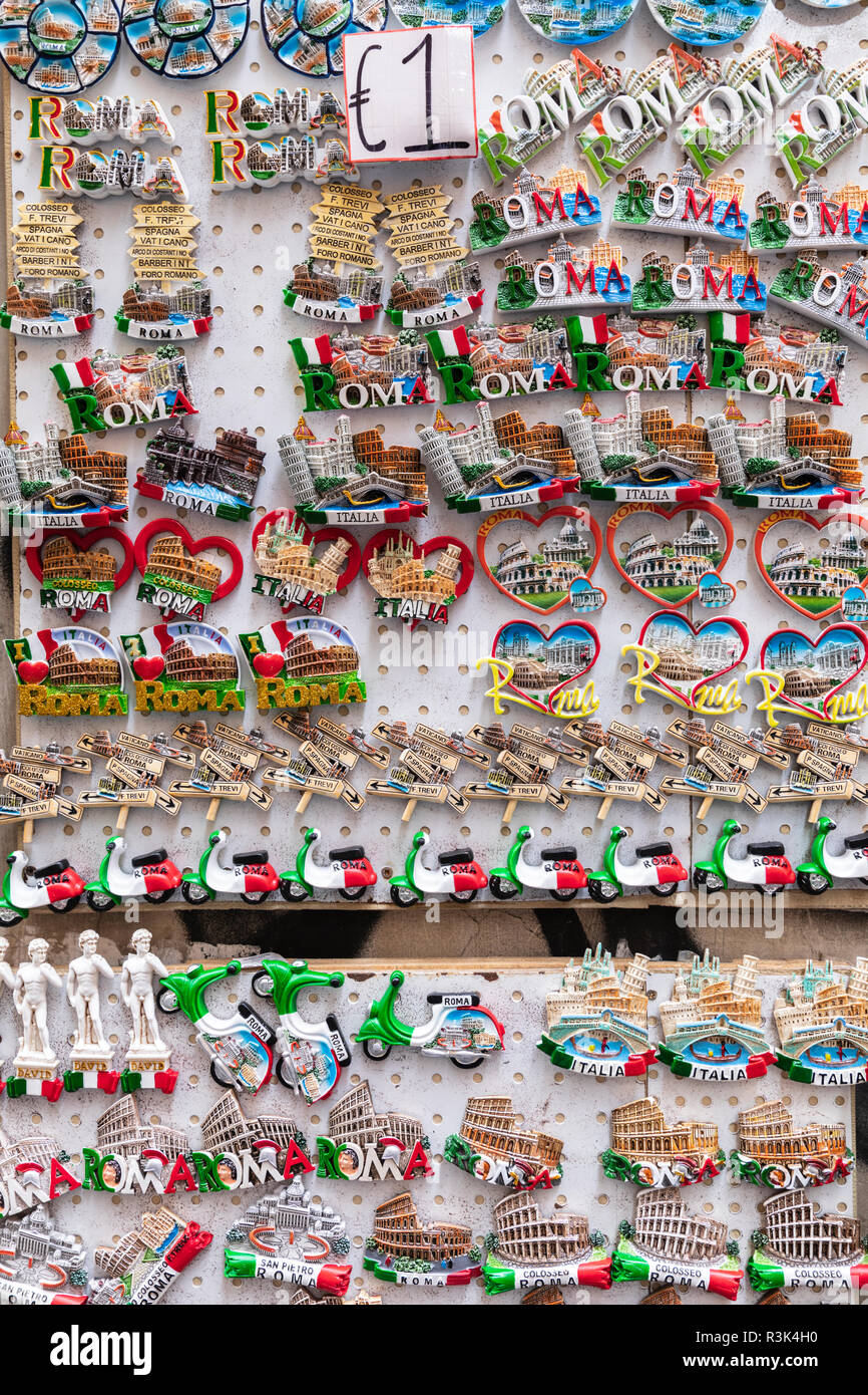 Detail of kitsch fridge magnets on sale for a Euro in Rome, Italy. - Stock Image
