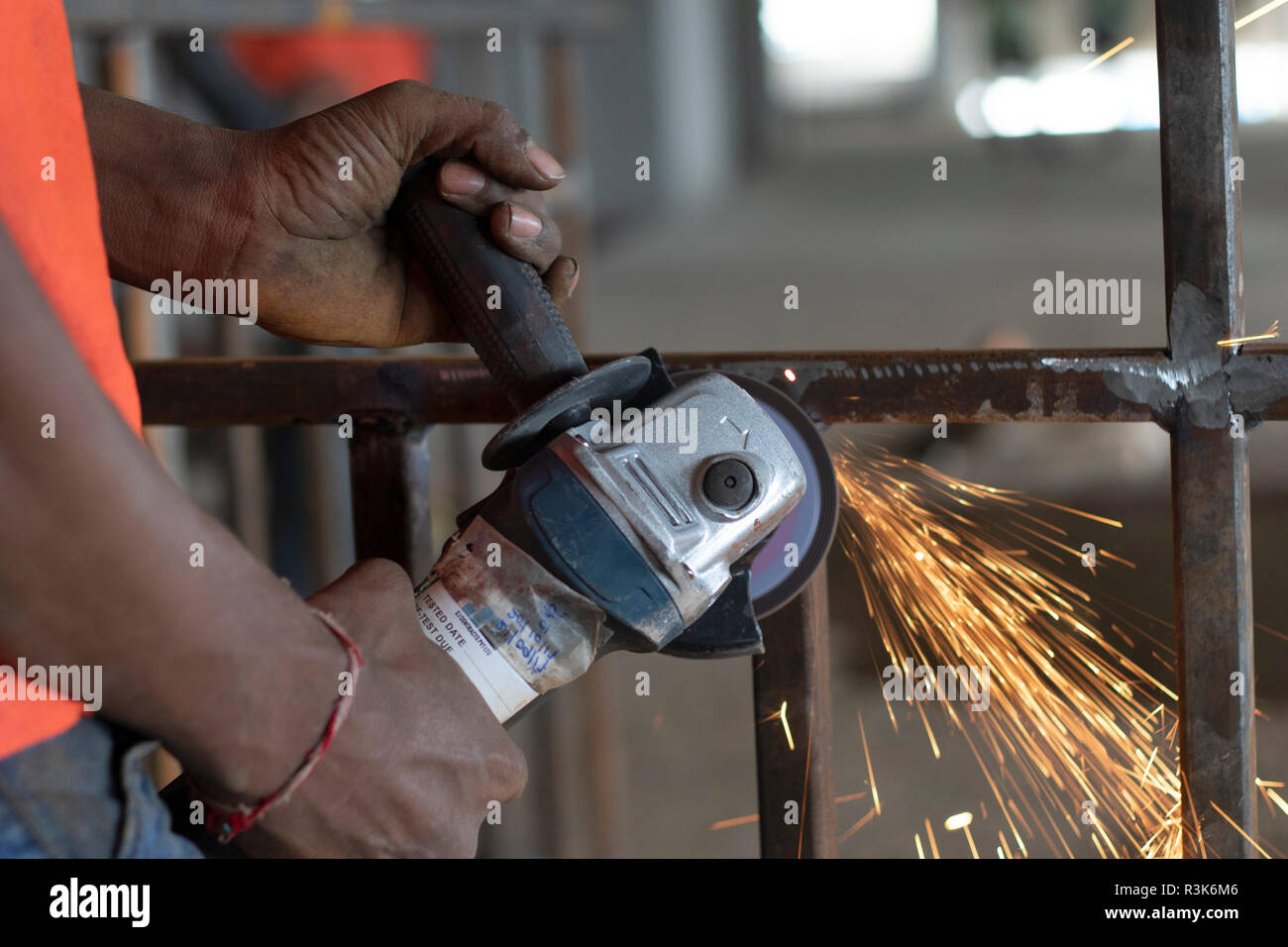 Person doing welding work, India. Stock Photo