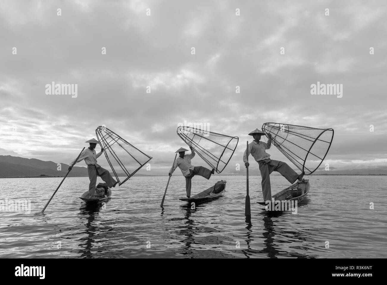 Fisherman display their conical nets used for fishing in Inle Lake, Myanmar. - Stock Image