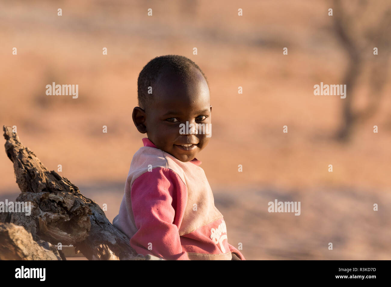 Africa, Namibia, Damaraland. Portrait of young boy. Credit as: Wendy Kaveney / Jaynes Gallery / DanitaDelimont.com Stock Photo