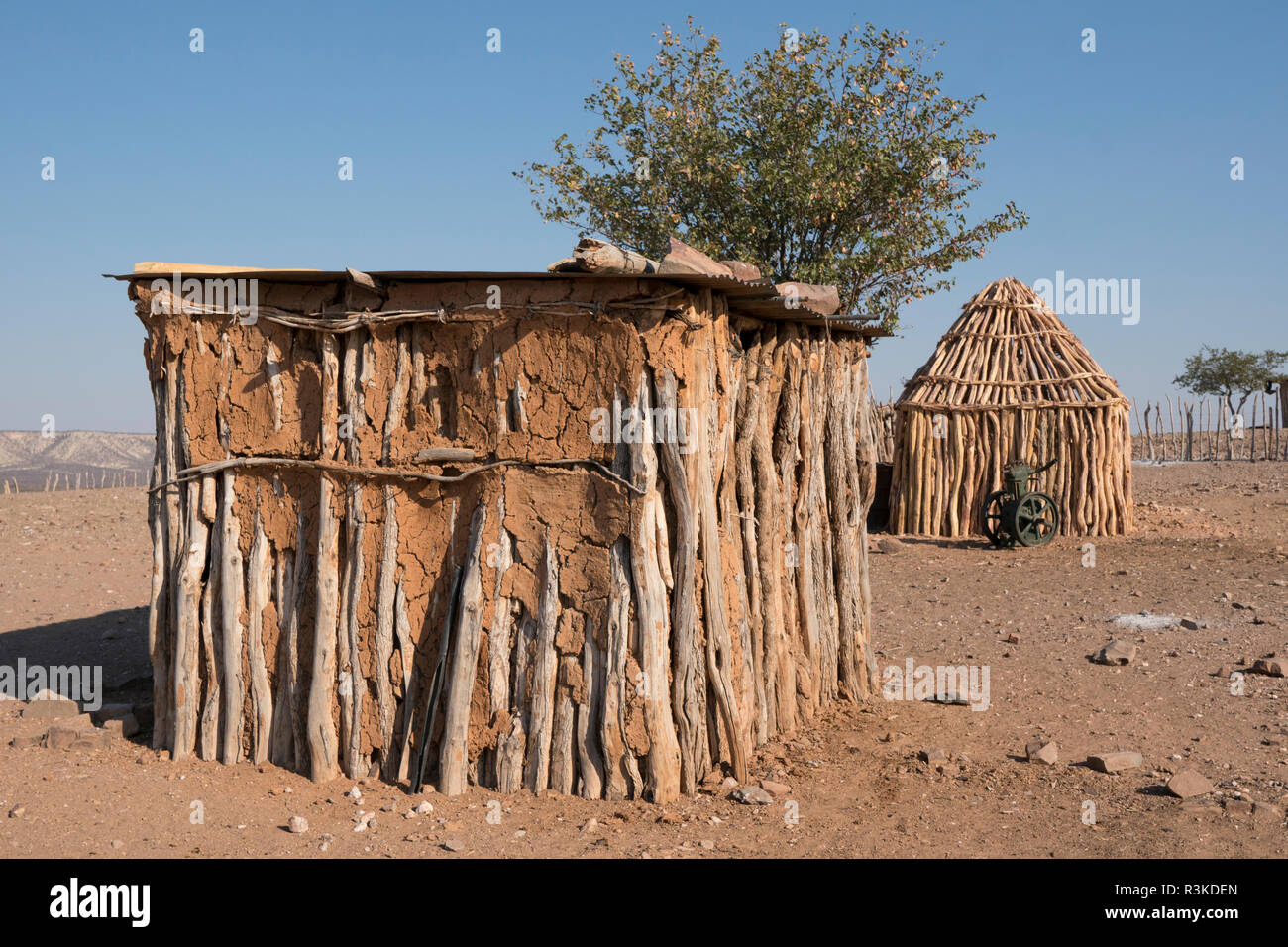 Traditional hut construction in a remote village outside of Opuwo, Namibia. - Stock Image