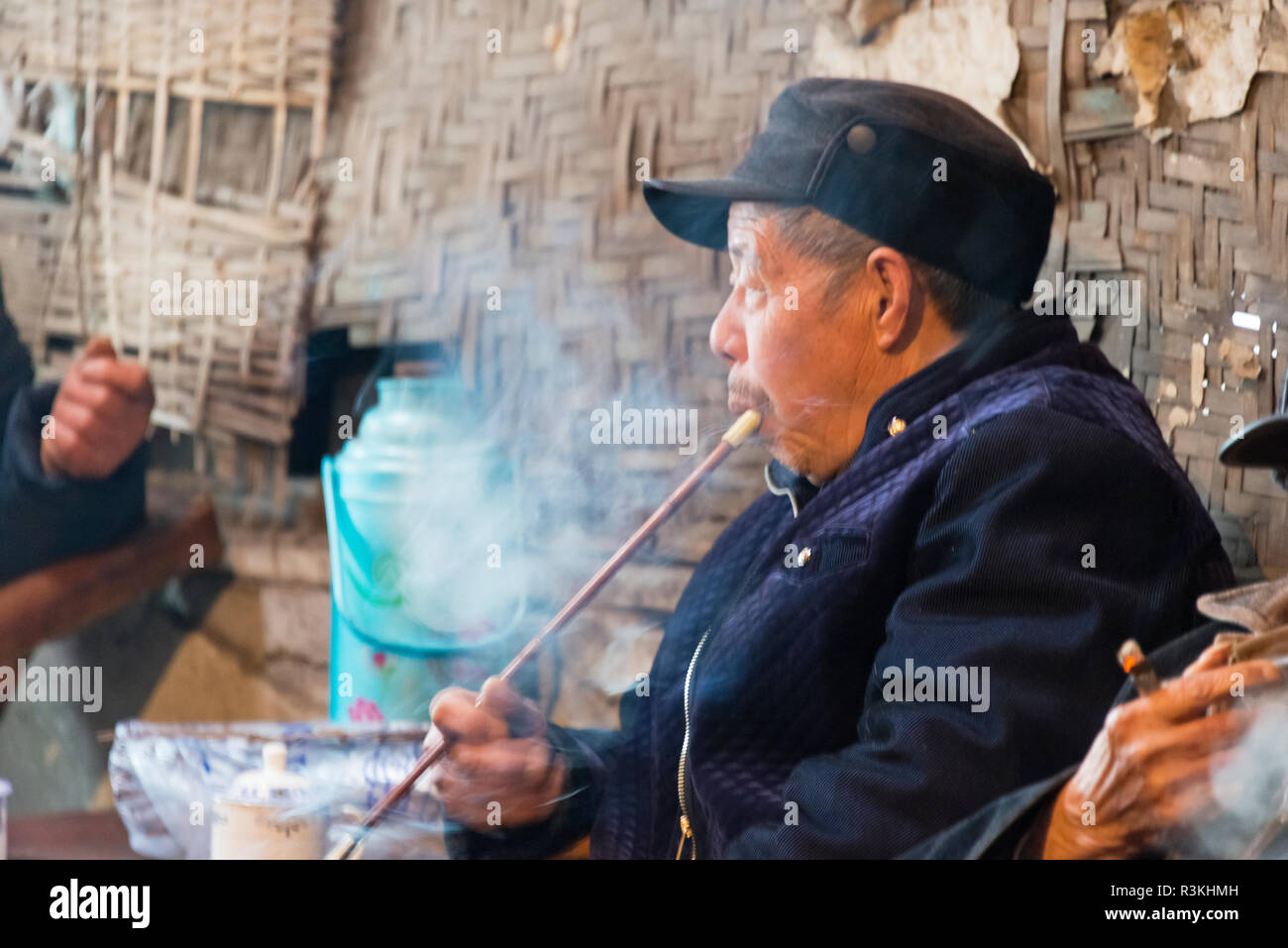 34921671a Old man smoking a pipe at an old teahouse, Pengzhen, Chengdu, Sichuan  Province, China