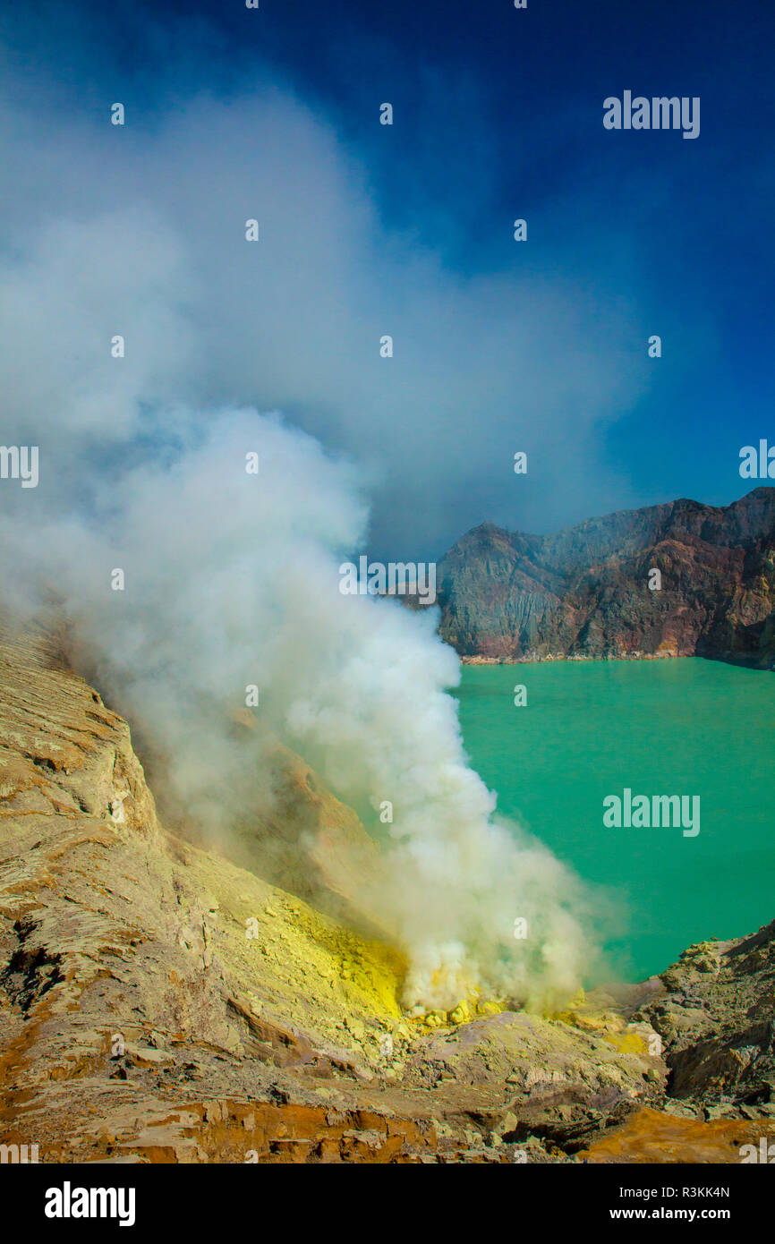 Indonesia, East Java. Sulfur dioxide smoke and volcanic lake in Ijen Crater. Credit as: Jim Zuckerman / Jaynes Gallery / DanitaDelimont. com - Stock Image