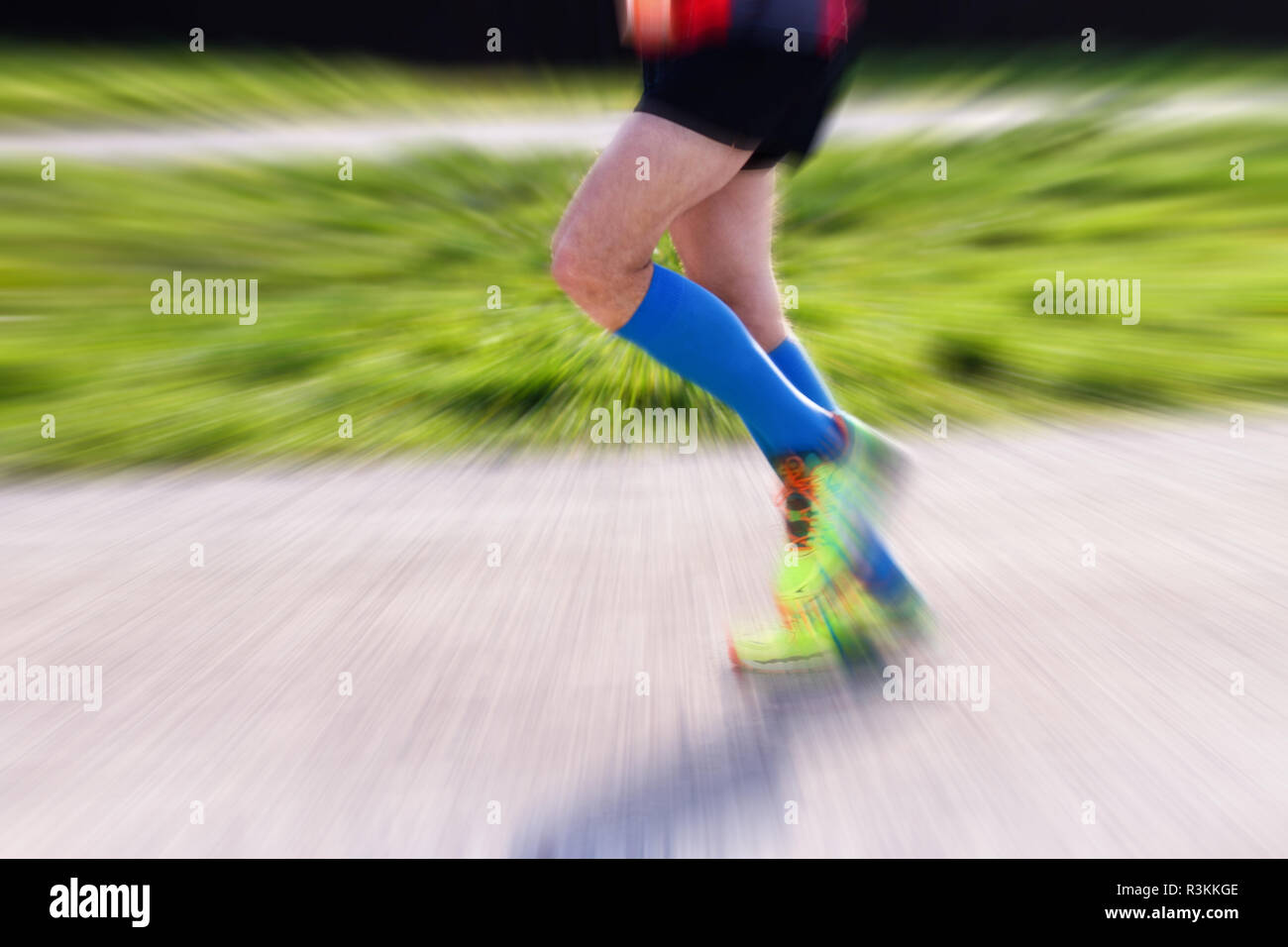 Warm up for the marathon. Male runner. - Stock Image