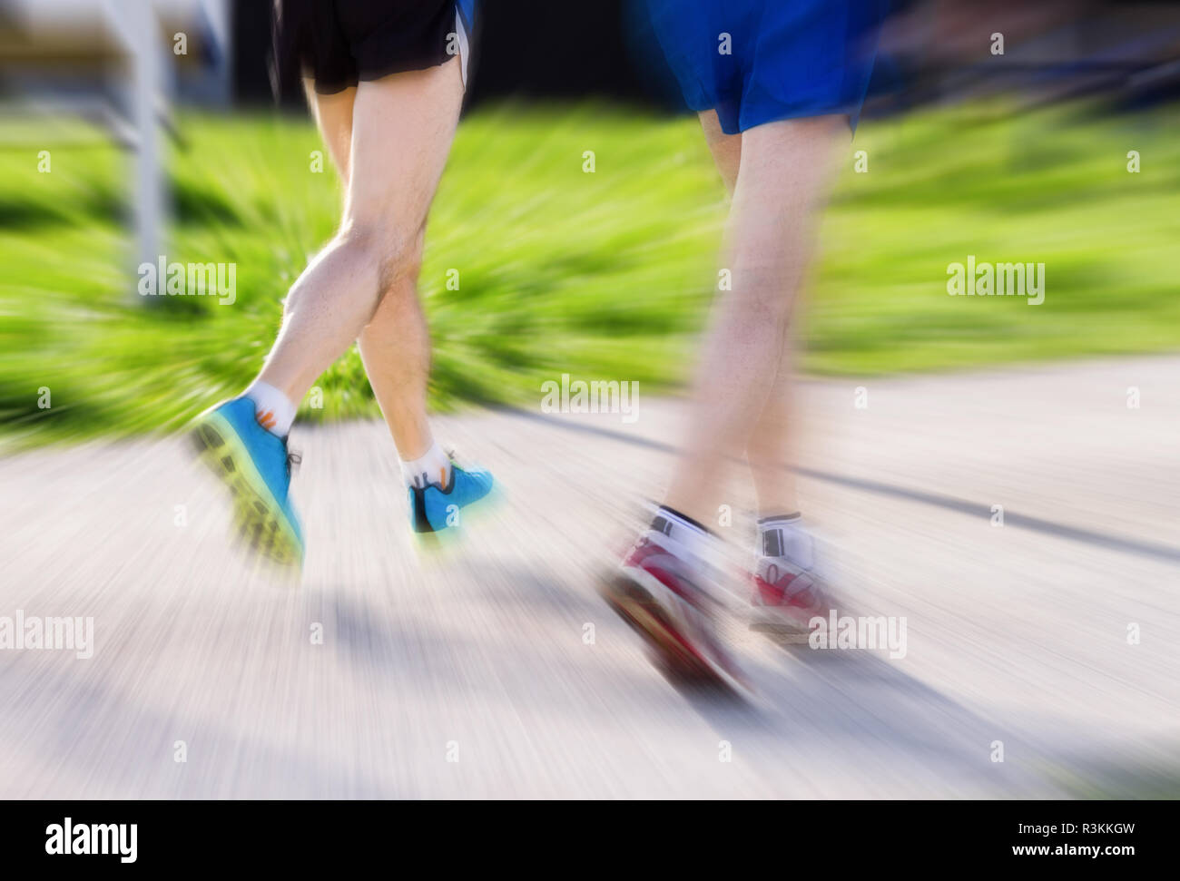 Warm up for the marathon. Male runners. - Stock Image