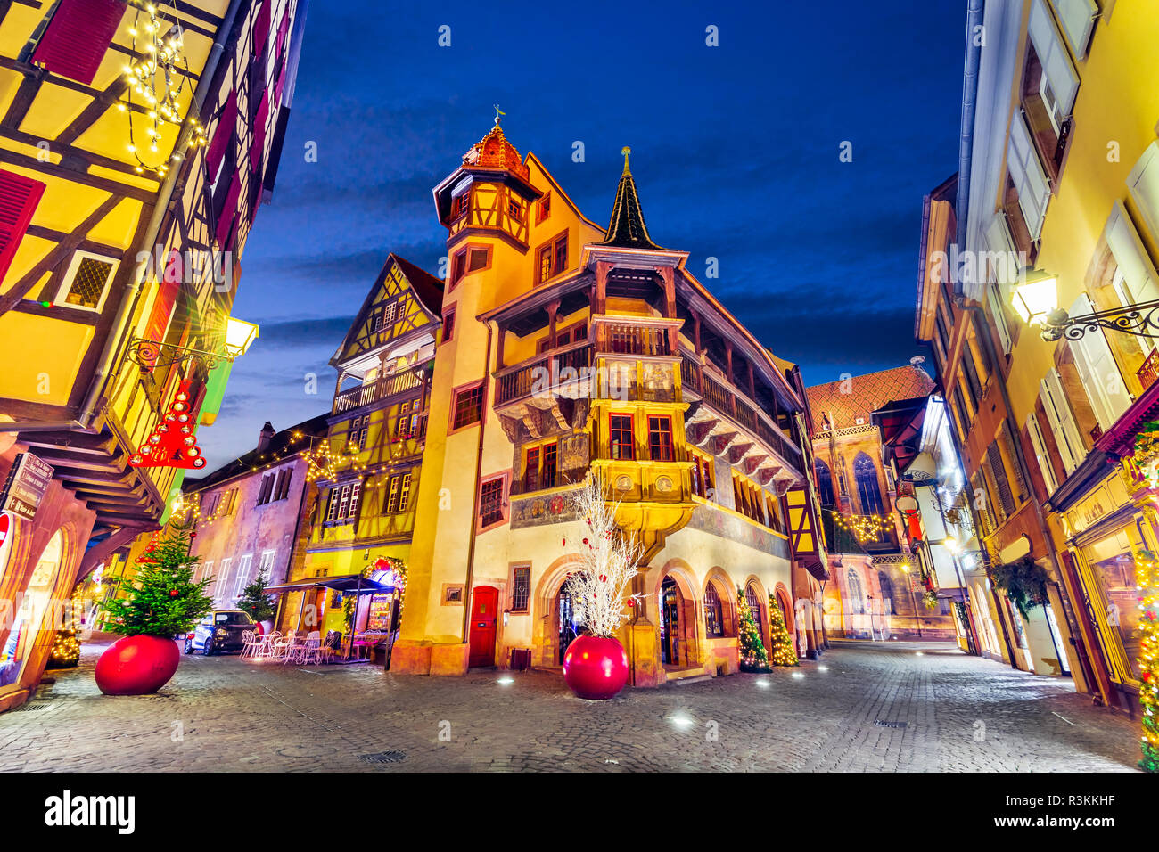 Colmar, France. Traditional Alsatian half-timbered houses Christmas decorated city in Alsace. - Stock Image