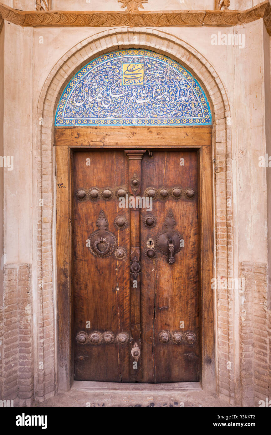 Central Iran, Kashan, Khan-E Boroujerdi, Traditional Carpet Merchant'S House, Ornate Door With Door Knockers For Male And Female Guests - Stock Image