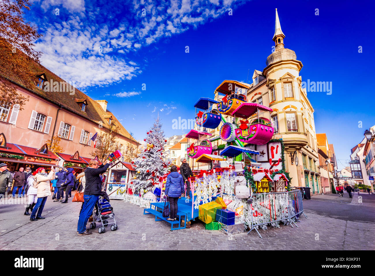 Colmar, France - December 2017. Christmas Market in Place des Dominicians, traditional Alsatian half-timbered Xmas decorated city in Alsace. - Stock Image