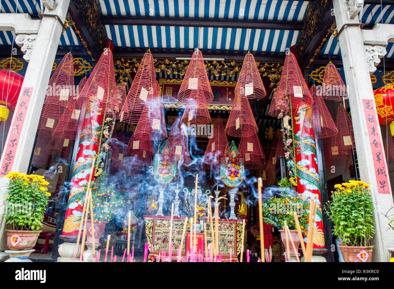 Pagoda with incense hanging from the ceiling. Hoi An. Tet Festival, New Year celebration. Vietnam. - Stock Image