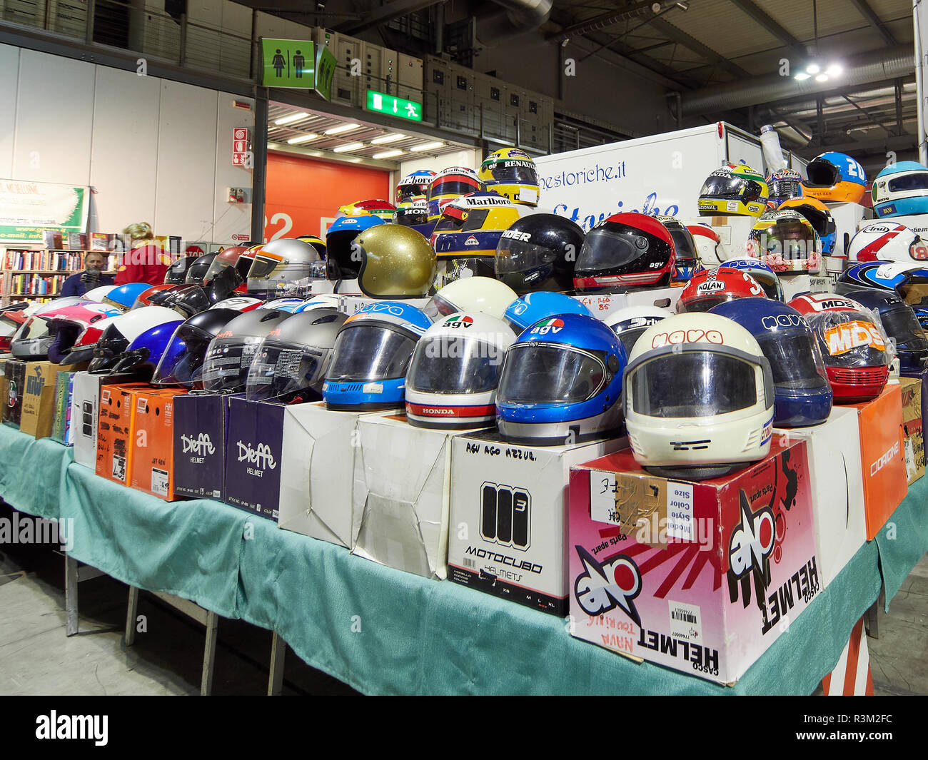 Milan, Lombardy Italy - November 23 , 2018 - Stand selling motorcycle or bike helmets at Autoclassica Milano 2018 edition at Fiera Milano Rho Credit: Armando Borges/Alamy Live News - Stock Image