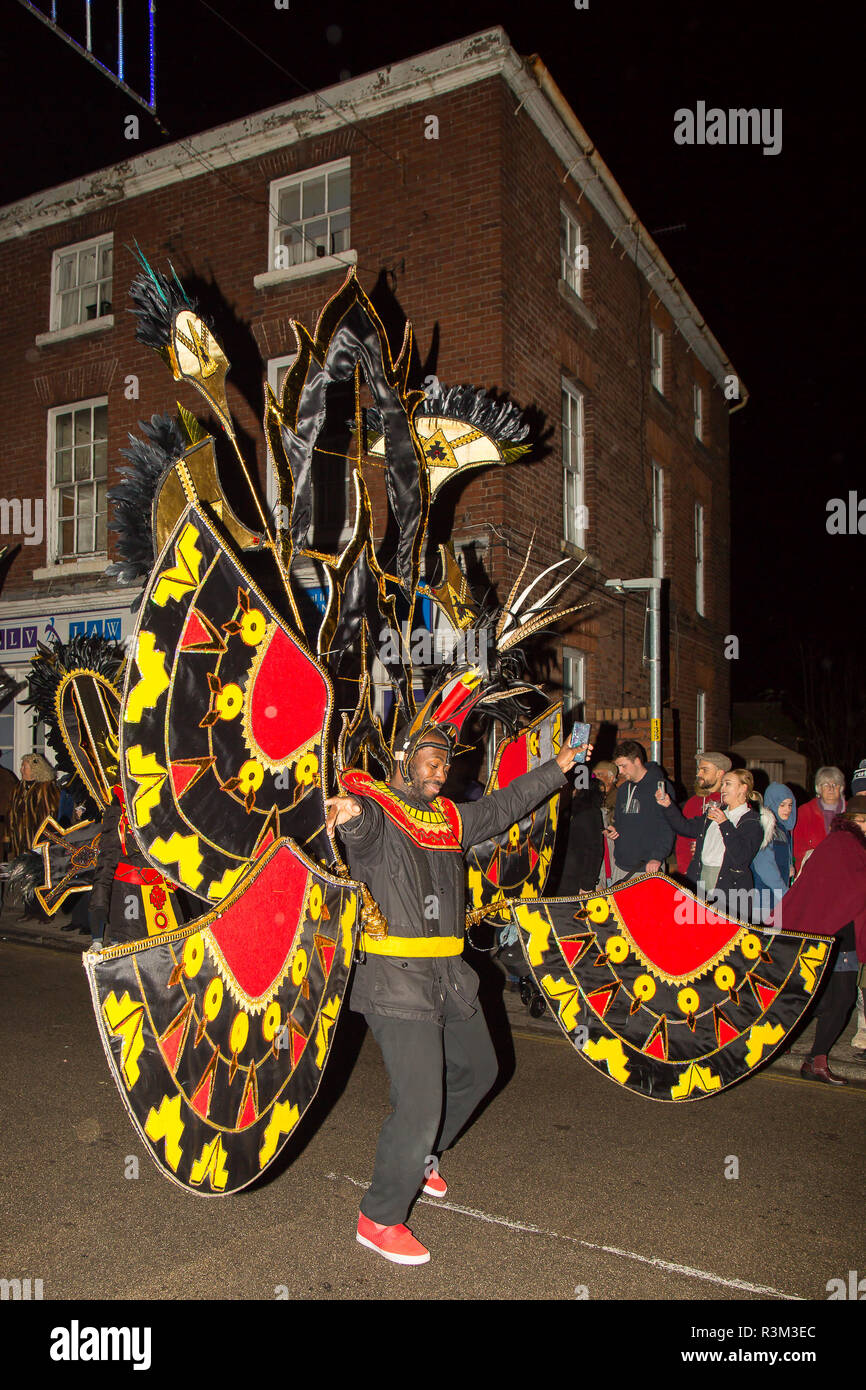 Stourport-on-Severn, UK. 23rd November, 2018. There is such a feeling of true community spirit as the folk of Stourport come together to support the town's traditional Christmas Three Kings Parade. Locals parade through the streets as the town's Christmas lights seem to magically turn on in front of them. The evening celebration ends with a spectacular firework display at the Civic Hall. Credit: Lee Hudson/Alamy Live News - Stock Image