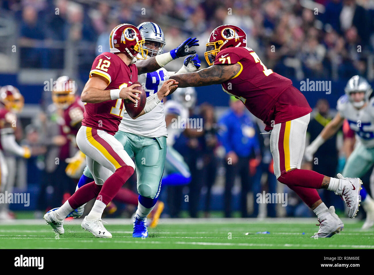 November 22, 2018:.Washington Redskins quarterback Colt McCoy (12) tries to get away from the line of scrimmages as Dallas Cowboys defensive tackle Daniel Ross (93) and Washington Redskins offensive tackle Trent Williams (71) battle.during an NFL football game between the Washington Redskins and Dallas Cowboys at AT&T Stadium in Arlington, Texas. .Manny Flores/CSM - Stock Image