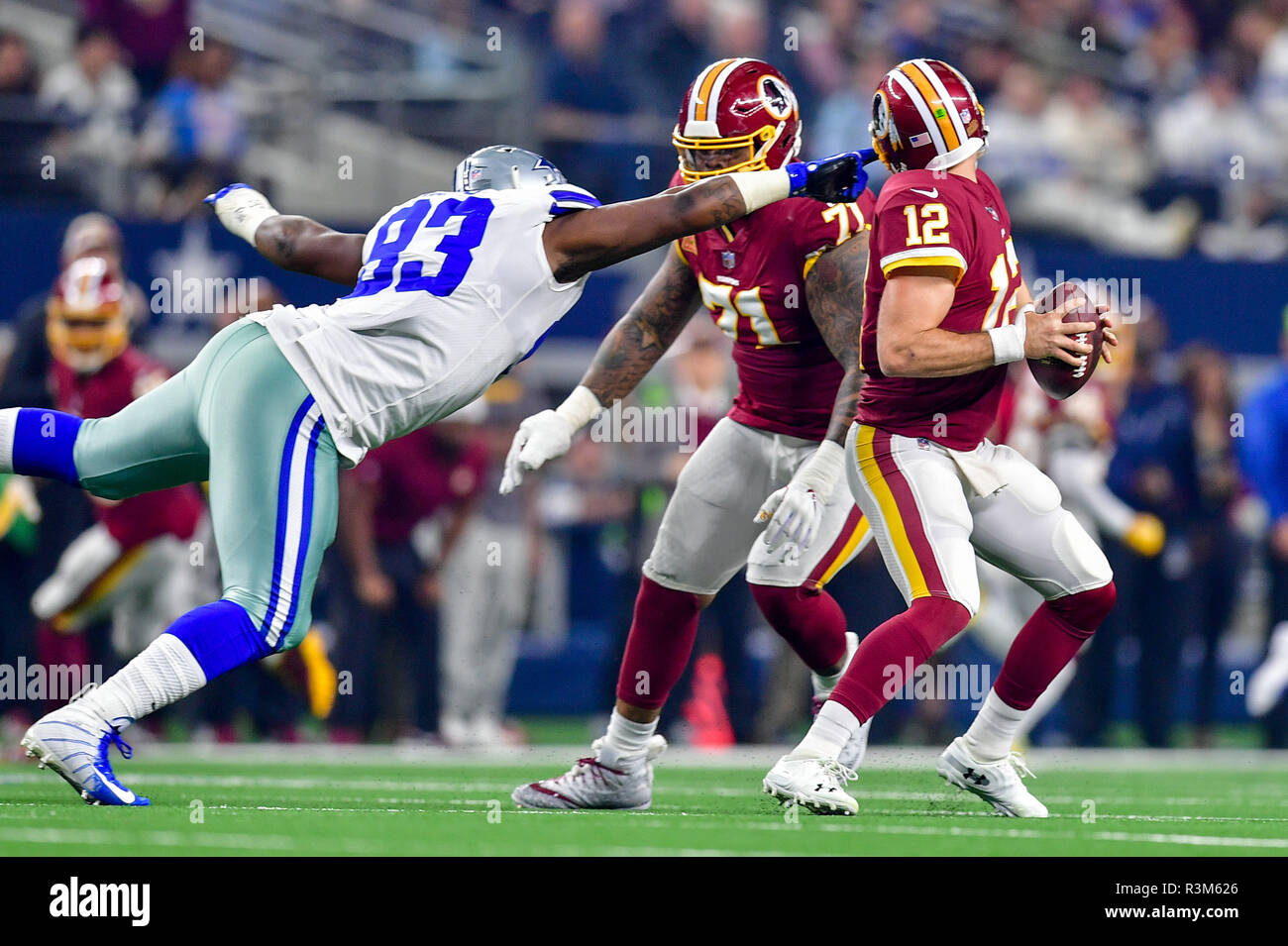 November 22, 2018:.Washington Redskins quarterback Colt McCoy (12) tries to elude Dallas Cowboys defensive tackle Daniel Ross (93) as he accidentally pulls on the face mask during an NFL football game between the Washington Redskins and Dallas Cowboys at AT&T Stadium in Arlington, Texas. .Manny Flores/CSM - Stock Image