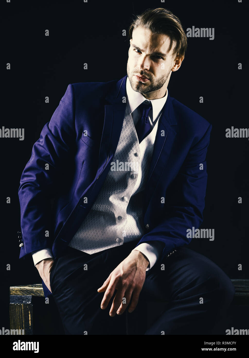 Businessman in formal wear with unshaven face and stylish haircut looks sharp. Young and successful concept. Serious man in classic suit or businessma - Stock Image