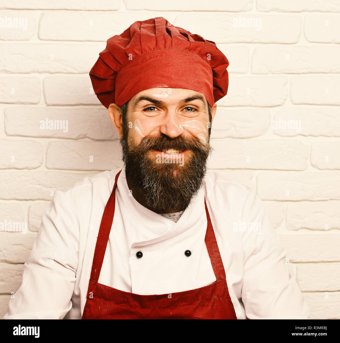 d9bf687a4a4f Chef with wide smile. Professions concept. Man with happy face in white brick  wall