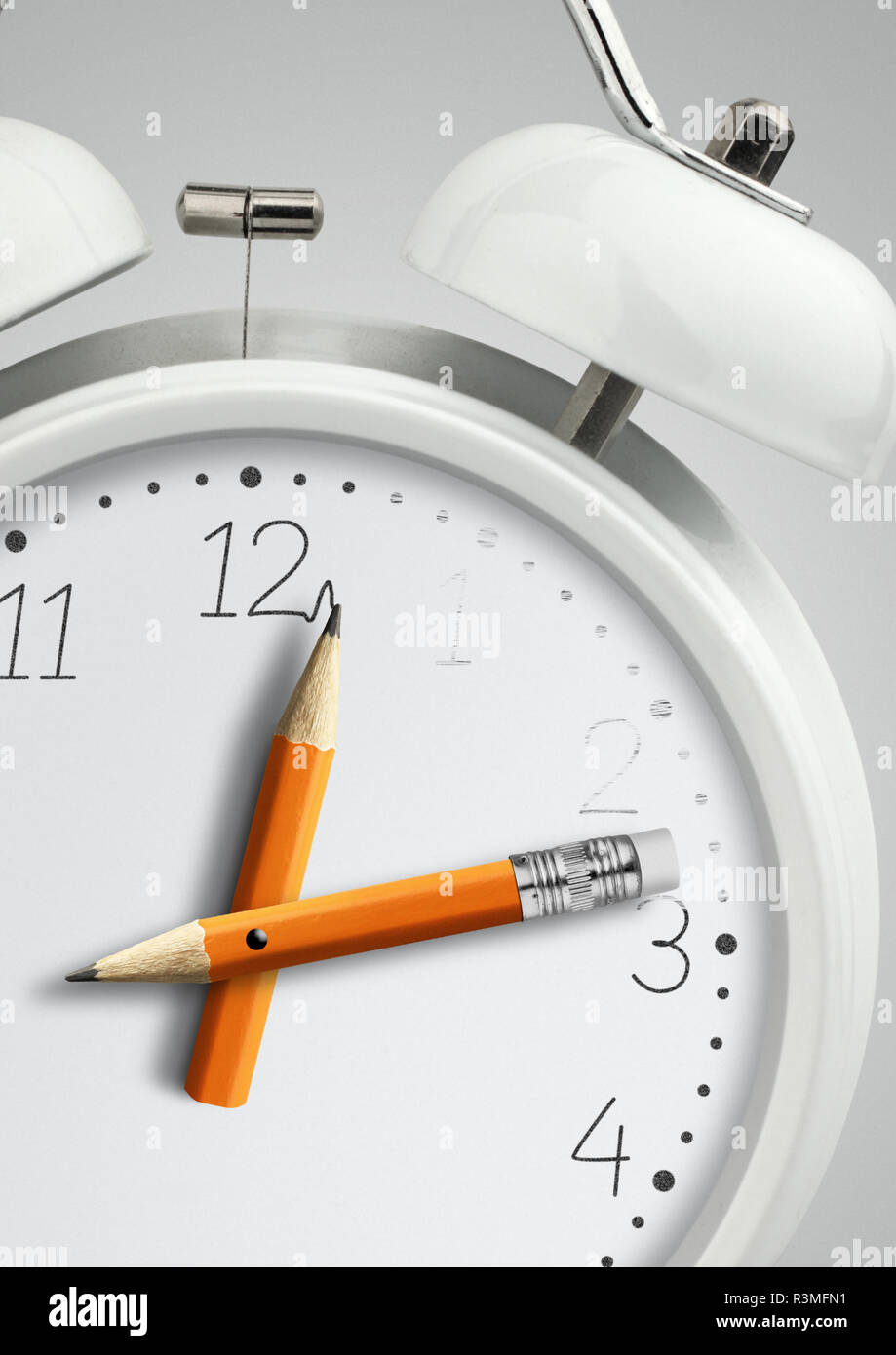 Time concept, clock with pencil clock hand, close-up - Stock Image
