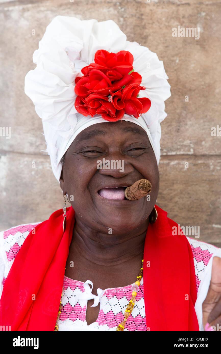 Cuba, Havana, Old Havana. Woman with cigar. Credit as: Wendy Kaveney / Jaynes Gallery / DanitaDelimont.com Stock Photo