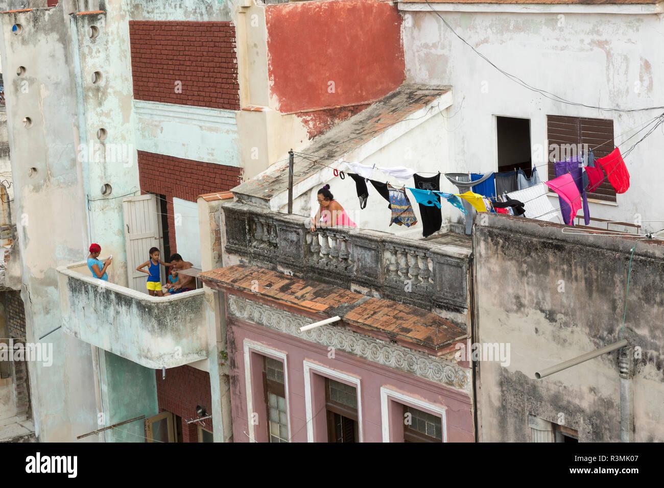 Cuba, Havana. People on their balconies. Credit as: Wendy Kaveney / Jaynes Gallery / DanitaDelimont.com Stock Photo