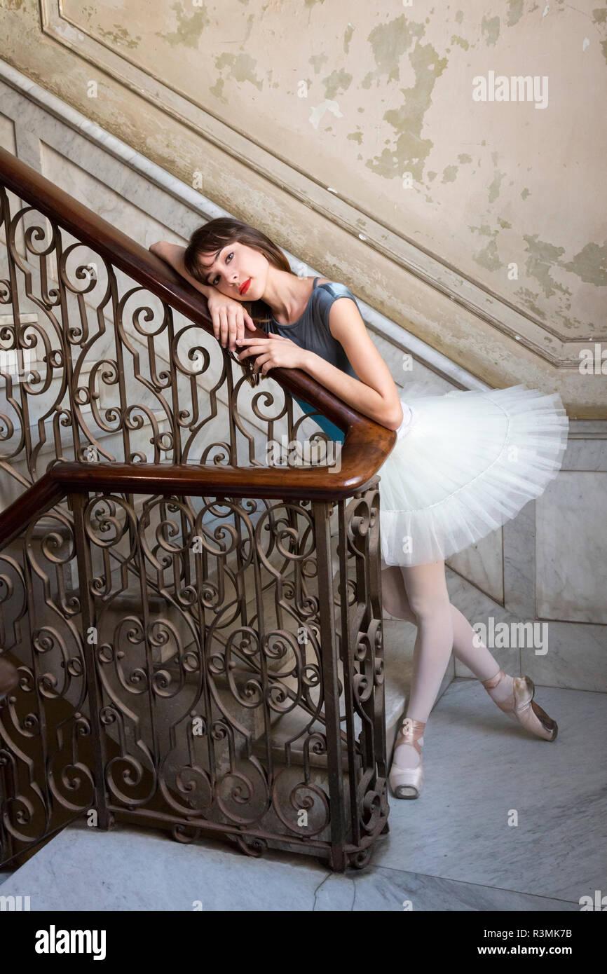 Cuba, Havana. Ballerina posing by antique staircase. Credit as: Wendy Kaveney / Jaynes Gallery / DanitaDelimont.com Stock Photo