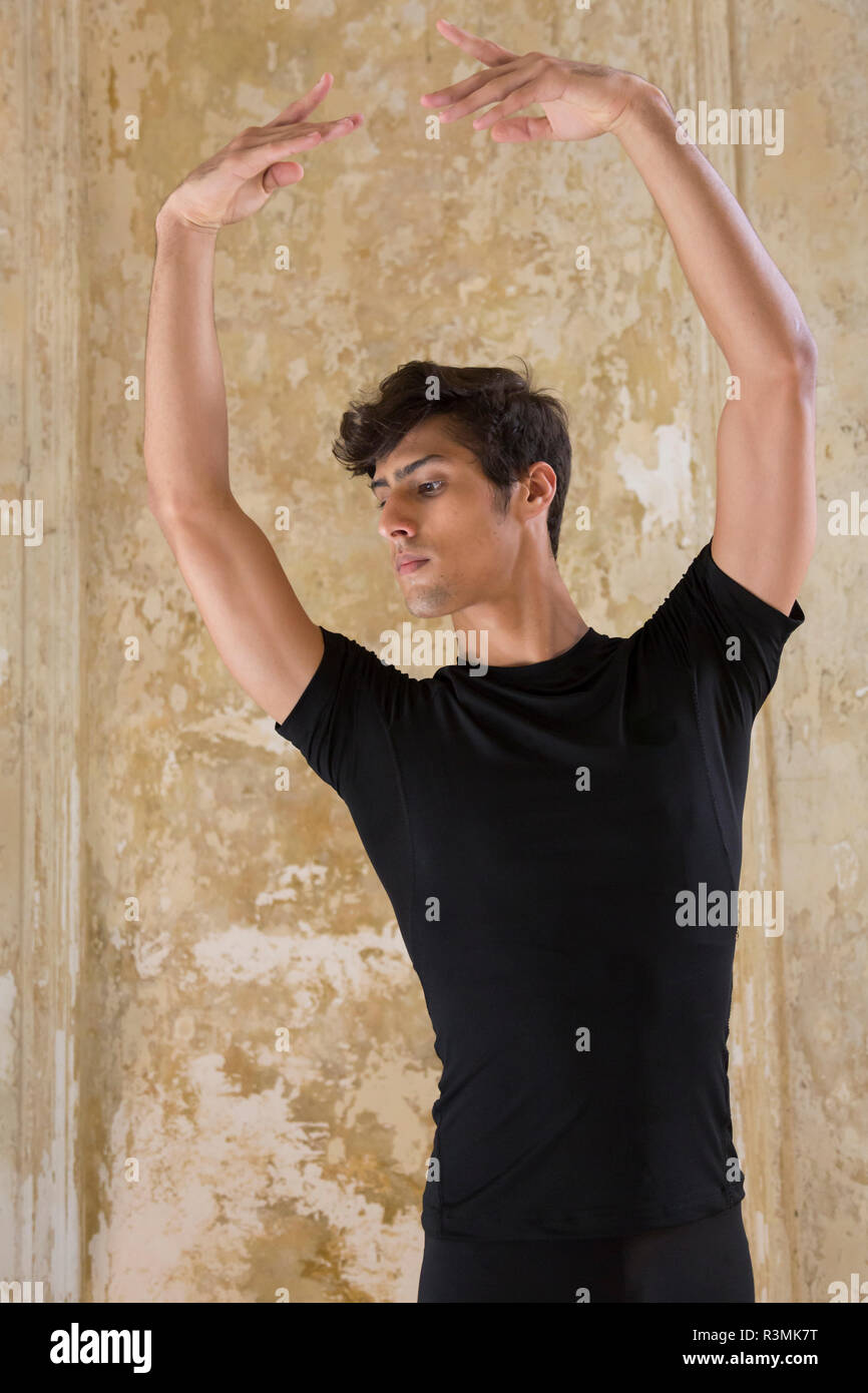 Cuba, Havana. Male dancer with ballet pose. Credit as: Wendy Kaveney / Jaynes Gallery / DanitaDelimont.com Stock Photo