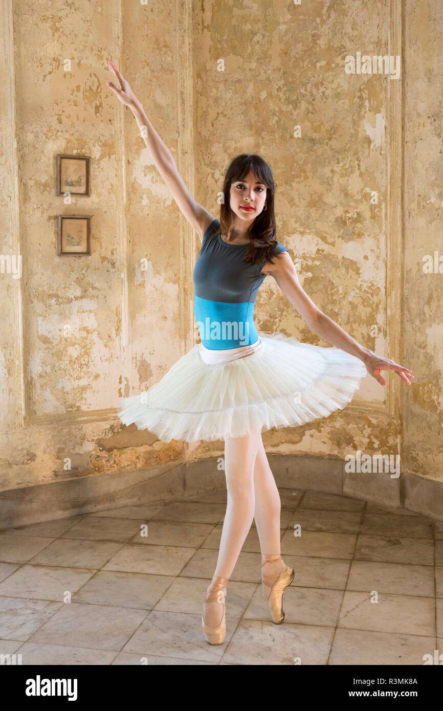 Cuba, Havana. Ballerina posing on toes. Credit as: Wendy Kaveney / Jaynes Gallery / DanitaDelimont.com Stock Photo