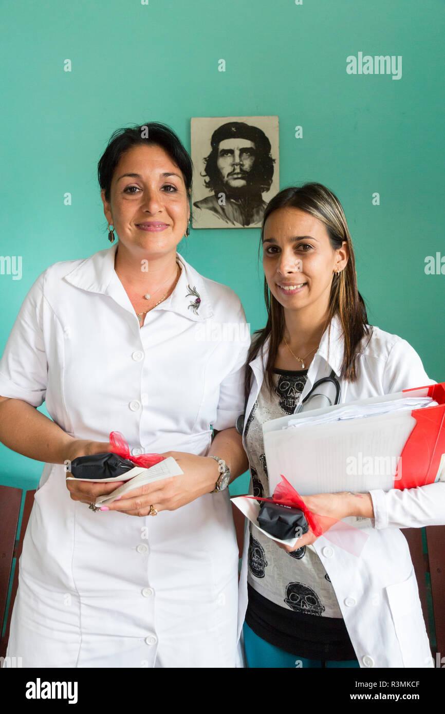 Cuba, Havana. Doctor and nurse in clinic. Credit as: Wendy Kaveney / Jaynes Gallery / DanitaDelimont.com Stock Photo