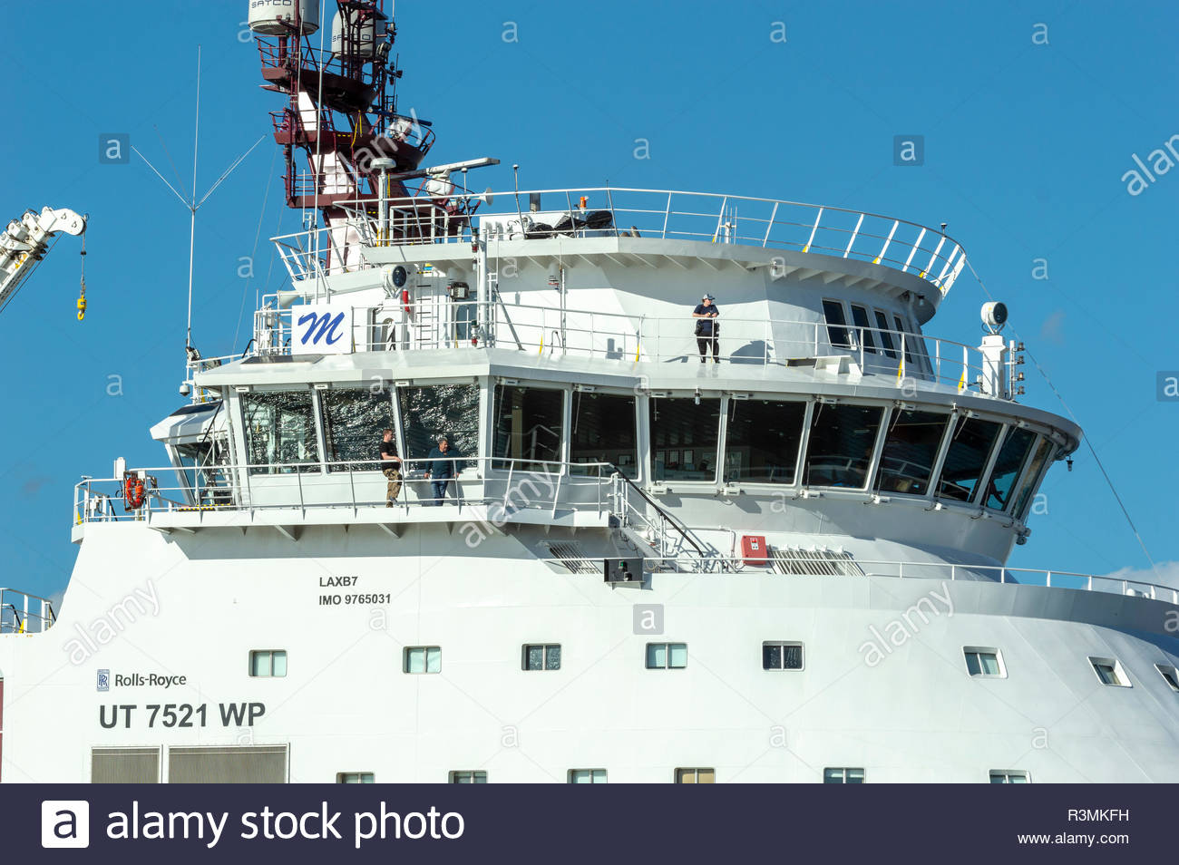 New Bedford, Massachusetts, USA - April 26, 2018: Superstructure of geotechnical drilling vessel Dina Polaris as it passes through hurricane barrier - Stock Image