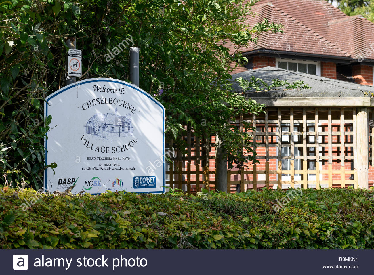 Cheselbourne Village School sign, Cheselbourne, Dorset, England, Britain, Europe UK GB - Stock Image