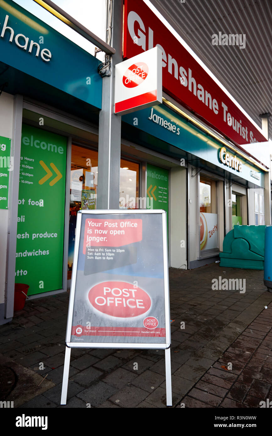 Post Office in a local service station supermarket showing later opening hours - Stock Image