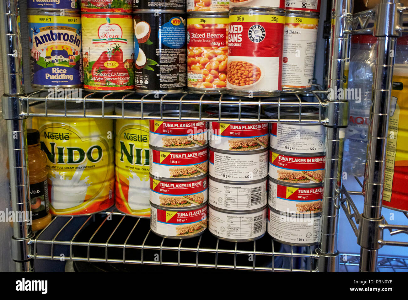 canned goods powdered milk stored in case of brexit emergency - Stock Image