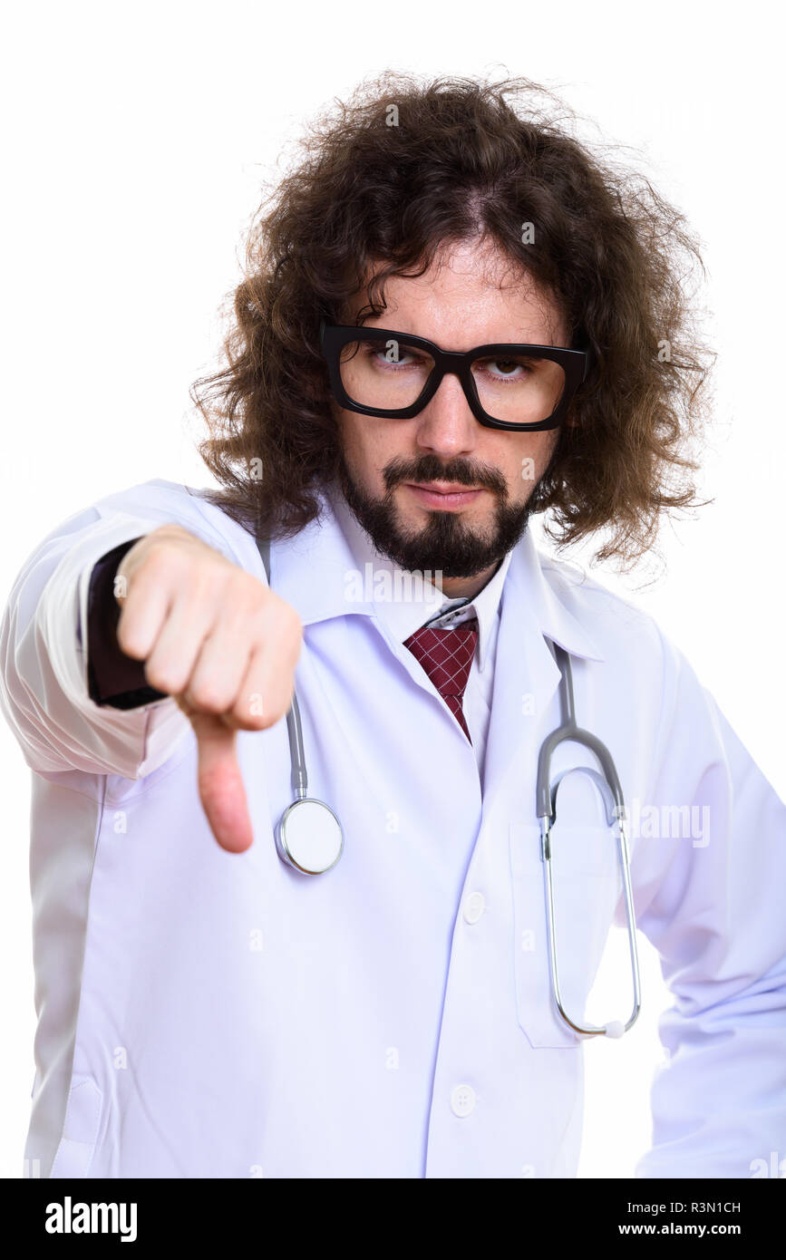 Portrait of disappointed man doctor giving thumb down - Stock Image