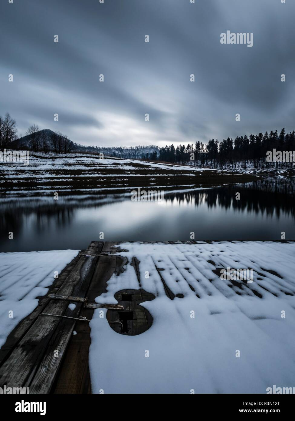 Long exposure early Winter snow in Europe Croatia Lokve lake destination Stock Photo