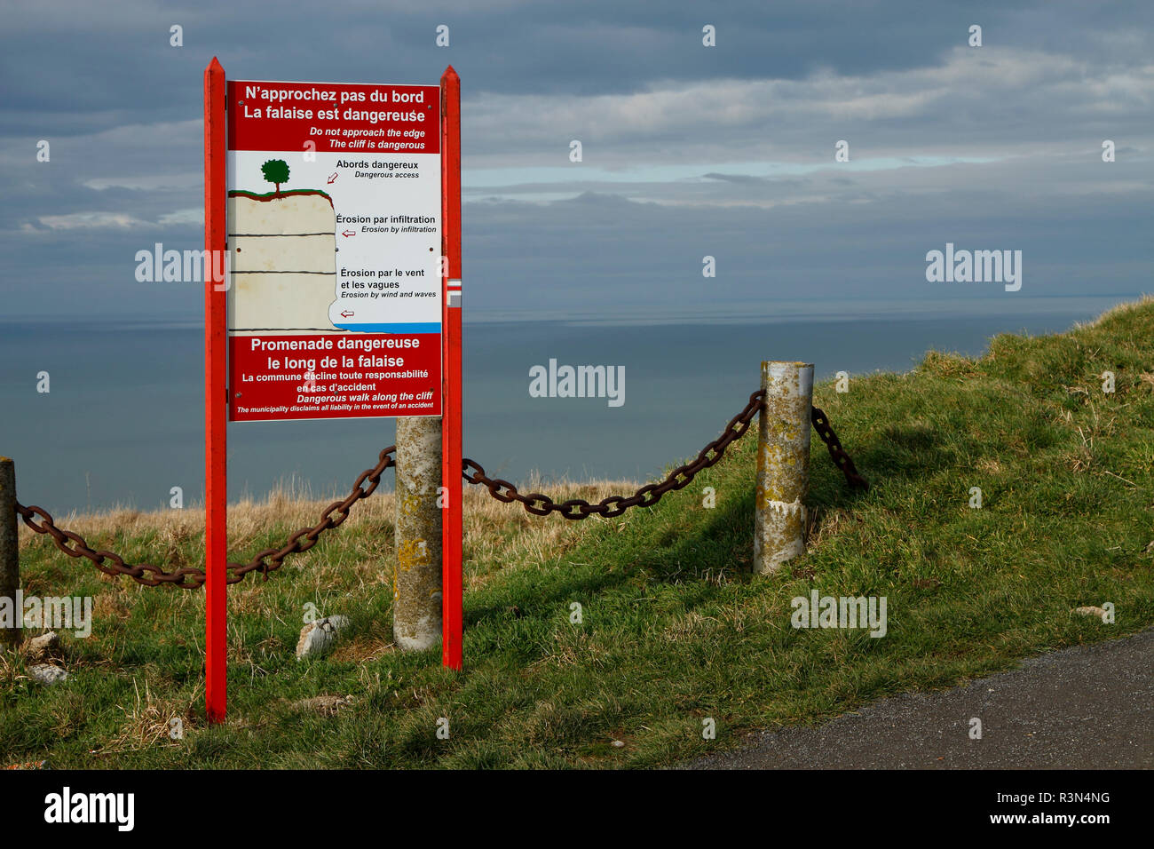 Information panel on the dangerous edge of the cliffs on the heights of Treport, Normandy, France Stock Photo