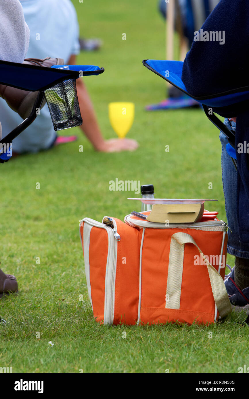 thermal picnic cooler on grass during outdoor event in the evening in the uk - Stock Image