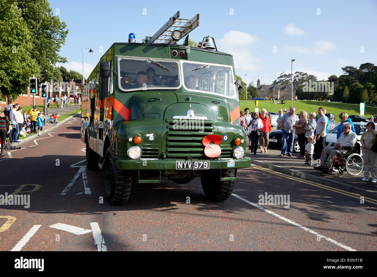 green old historic military bedford green goddess fire engine taking part in a vintage historic car rally in northern ireland - Stock Image