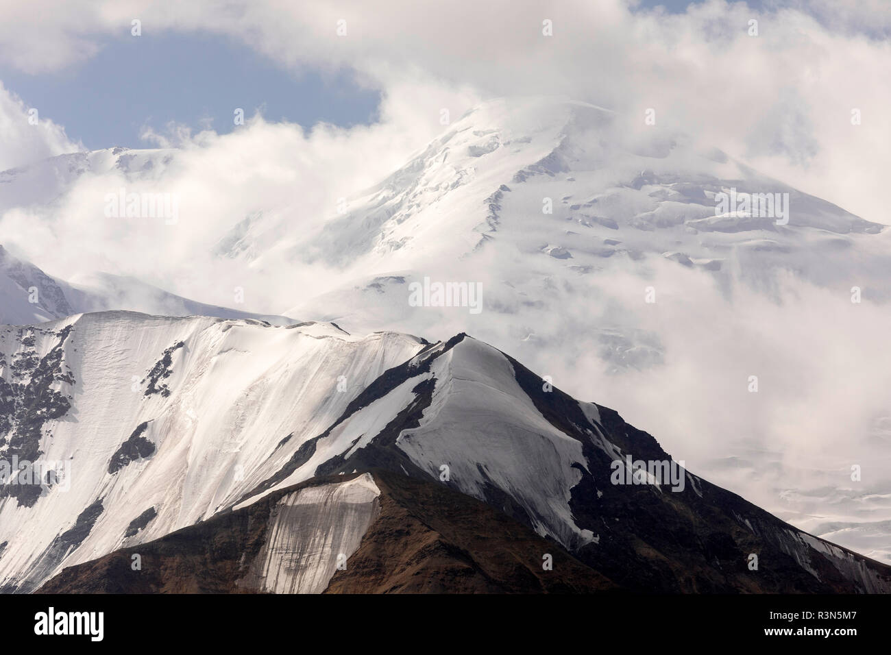 Pamir mountains with peak Lenin, which is shrouded by clouds, Kyrgyzstan Stock Photo