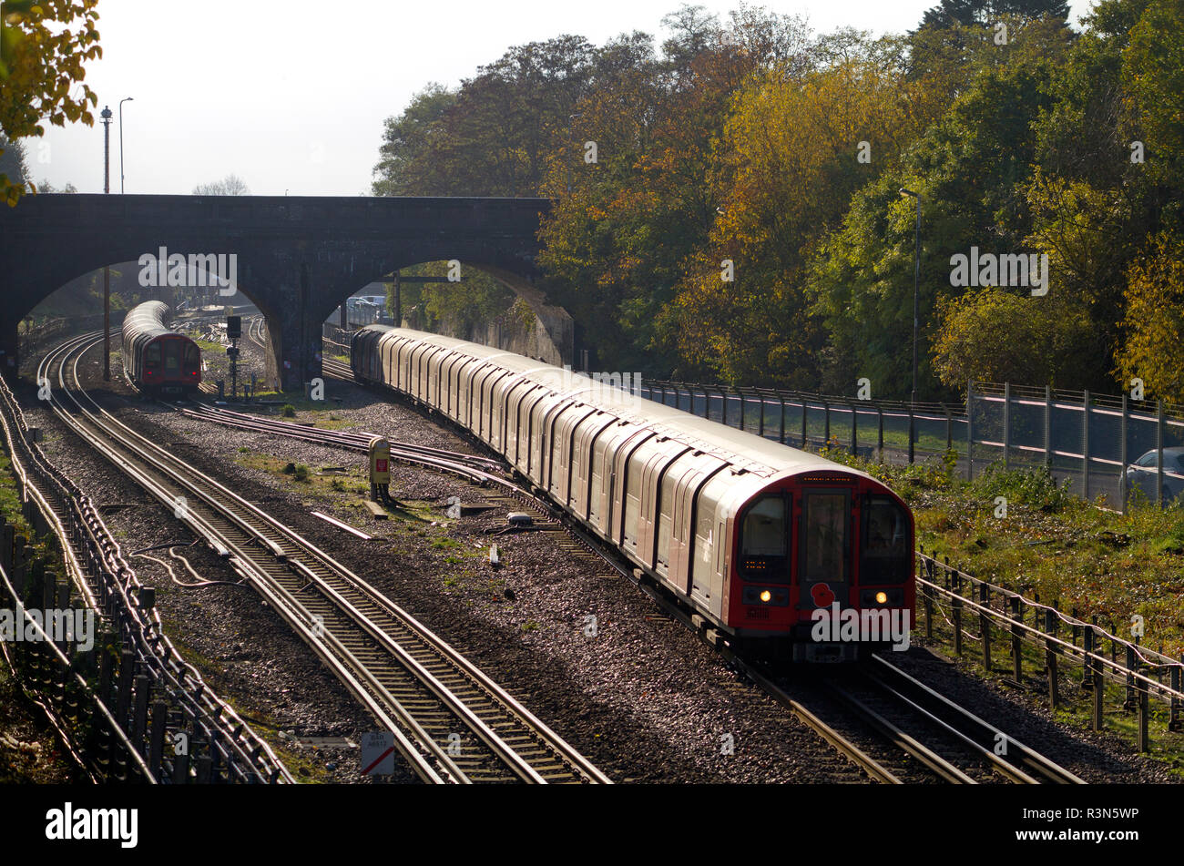 A Central Line train formed of London Underground 1992 stock heads north at Newbury Park. 9th November 2018. Stock Photo