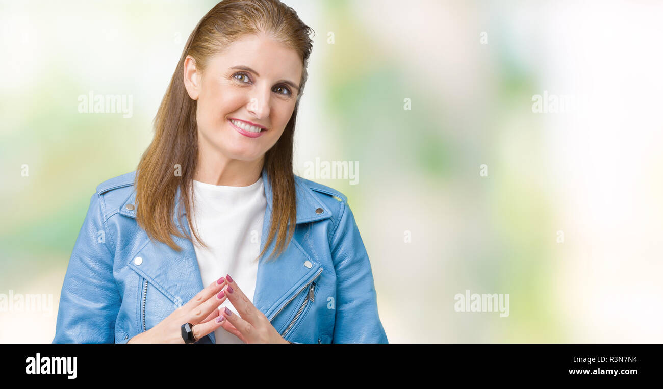 4b9c2a111fdce Beautiful middle age mature woman wearing fashion leather jacket over  isolated background Hands together and fingers