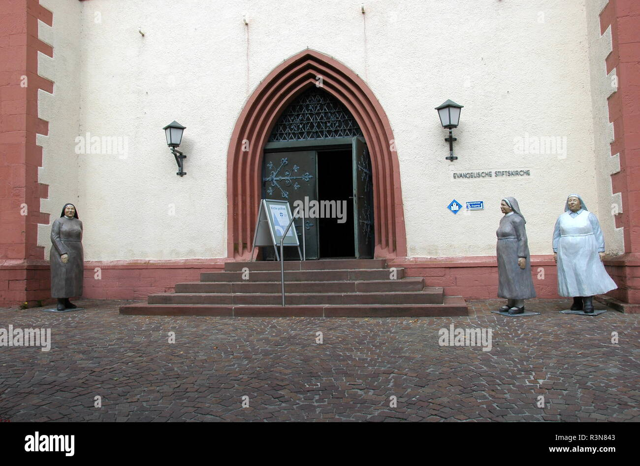 everyday people in front of church in mosbach / baden Stock Photo